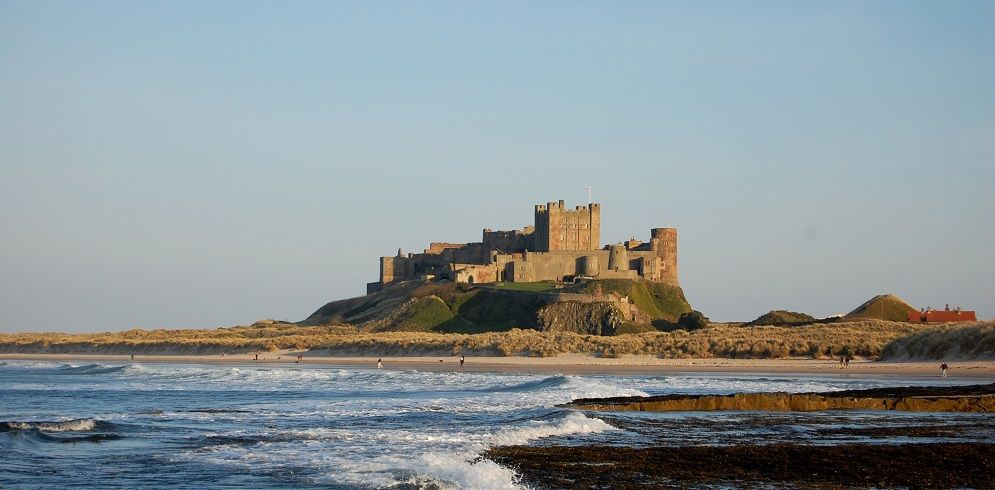 Bamburgh Castle and beach on the Coast and Castles Cycling Route
