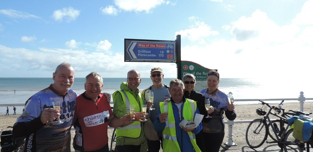 Seven cyclists at the end of the Way of the Roses cycling tour in Bridlington