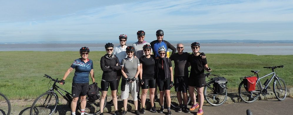 Group of cyclists just before starting a stage of the Coast to Coast tour.